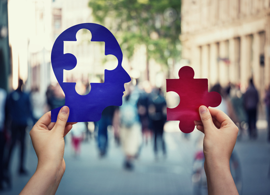 2 hands holding puzzle pieces