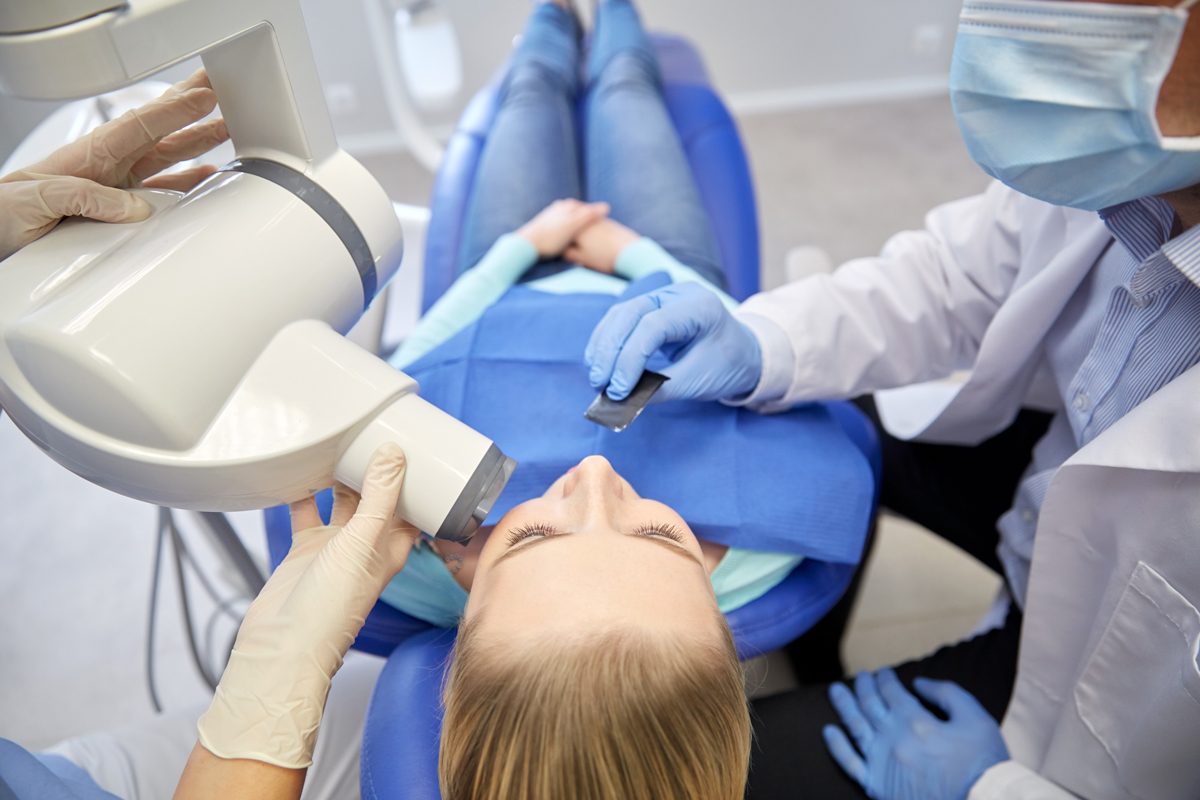 dental room procedure. Woman in chair